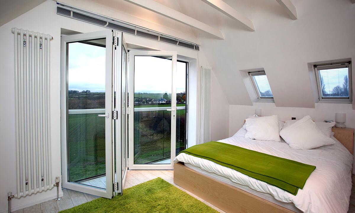Bedroom with white uPVC bifold doors