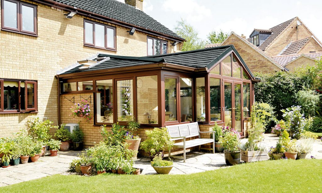 Bespoke P-Shaped conservatory with a tiled roof