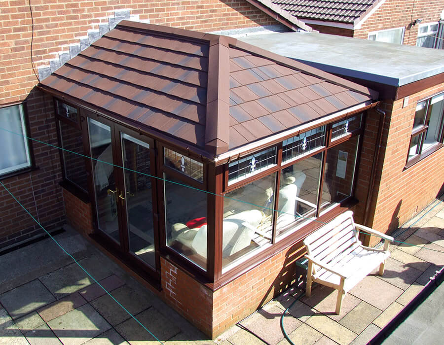 uPVC edwardian conservatory with a brown tiled roof
