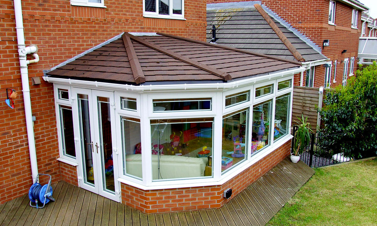 uPVC victorian conservatory with a brown tiled roof