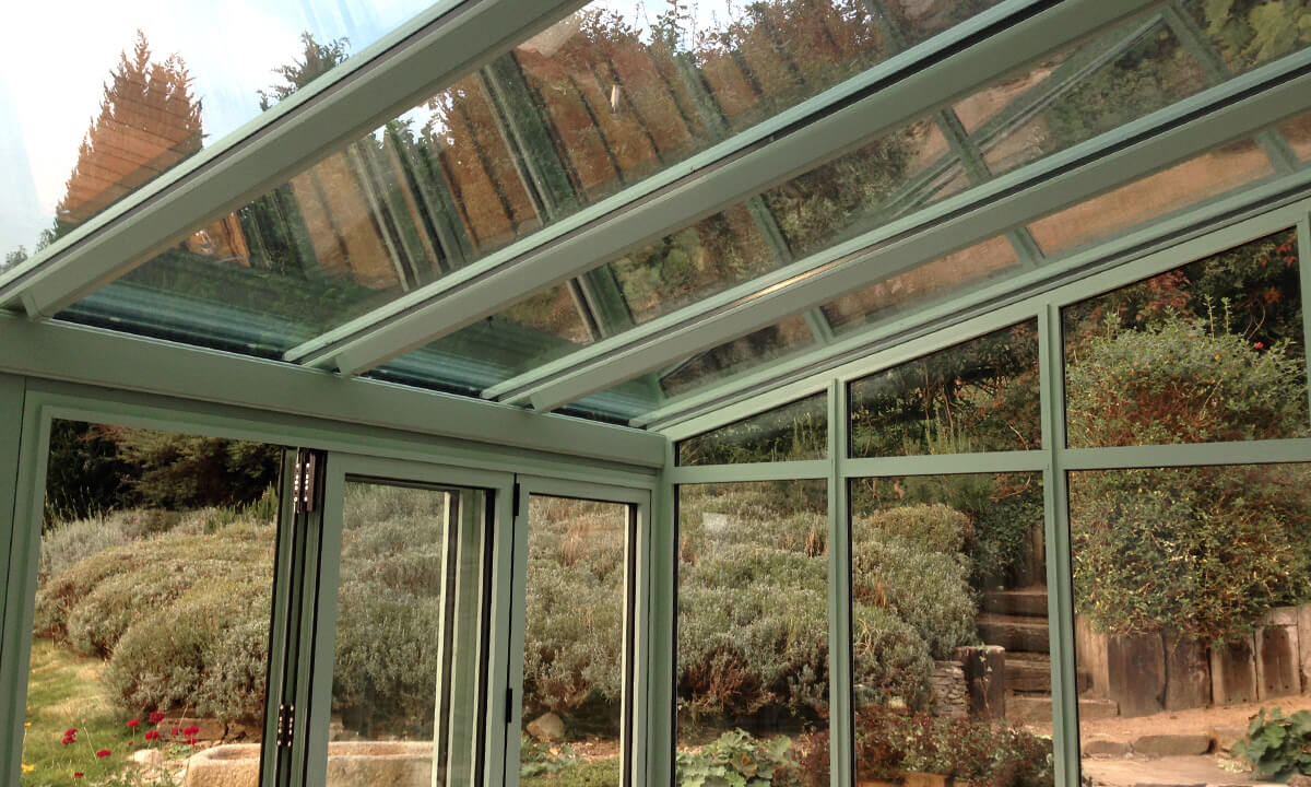 Chartwell green conservatory with a glass roof