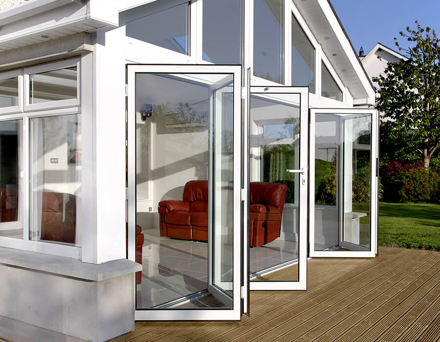 Conservatory with open white uPVC bifold doors