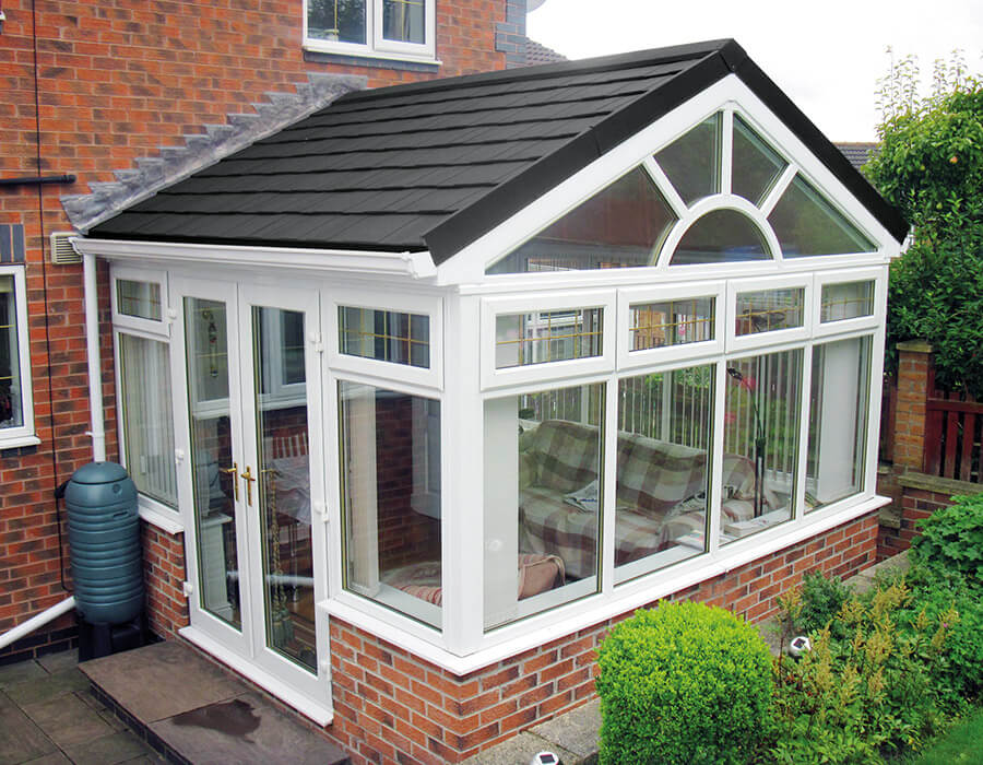 White uPVC gable conservatory with a grey tiled roof