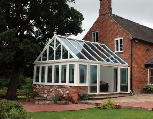White uPVC gable conservatory with a glass roof