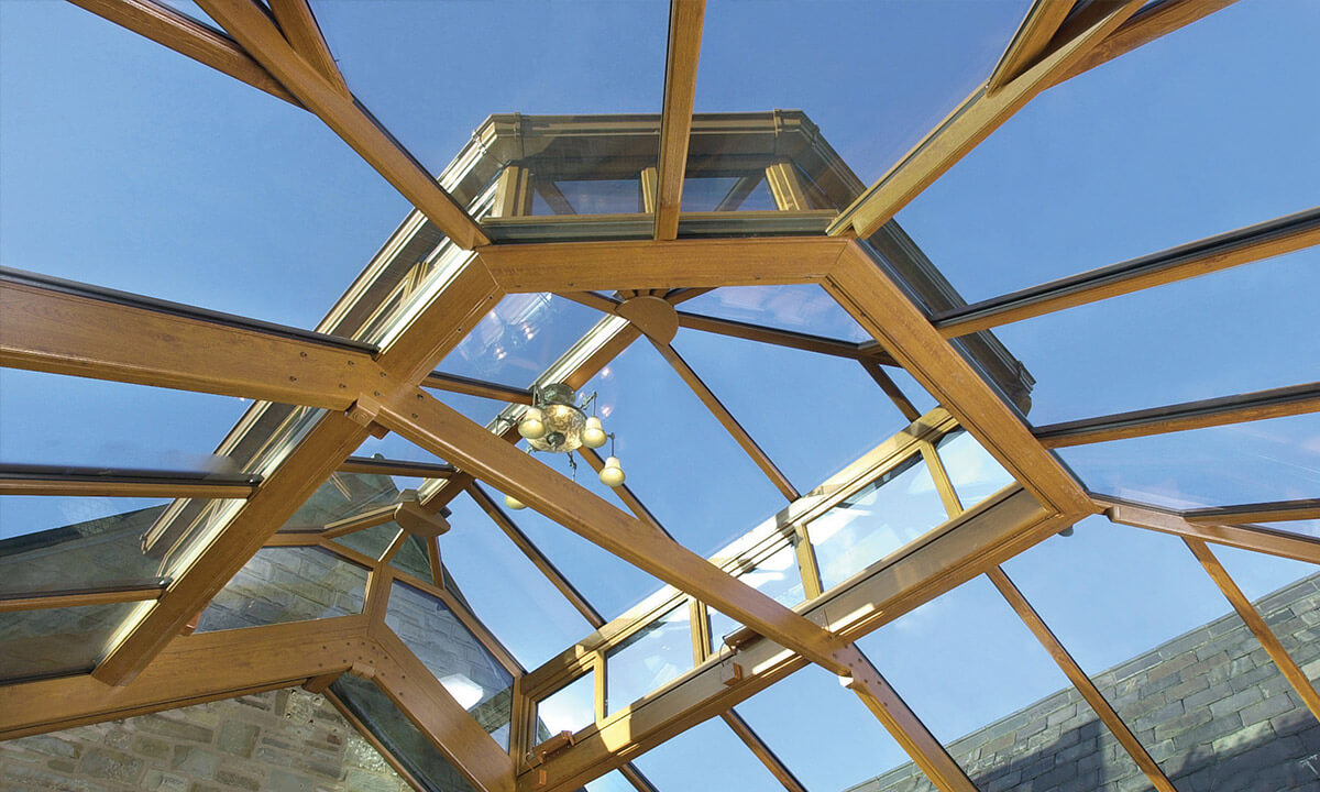 Interior view of a glass conservatory roof with an irish oak coloured frame
