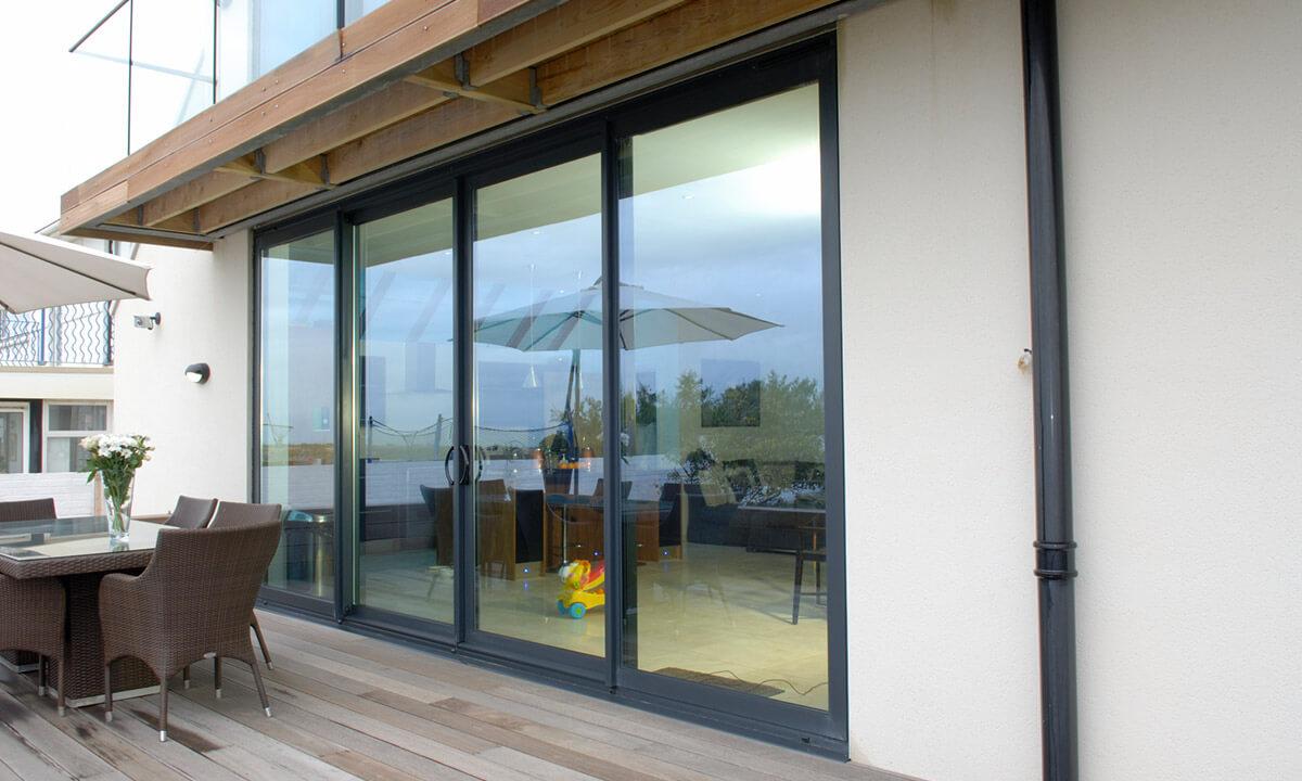 Grey aluminium sliding patio door