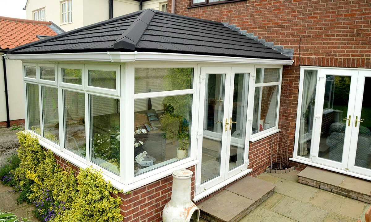 White uPVC conservatory with a grey tiled roof