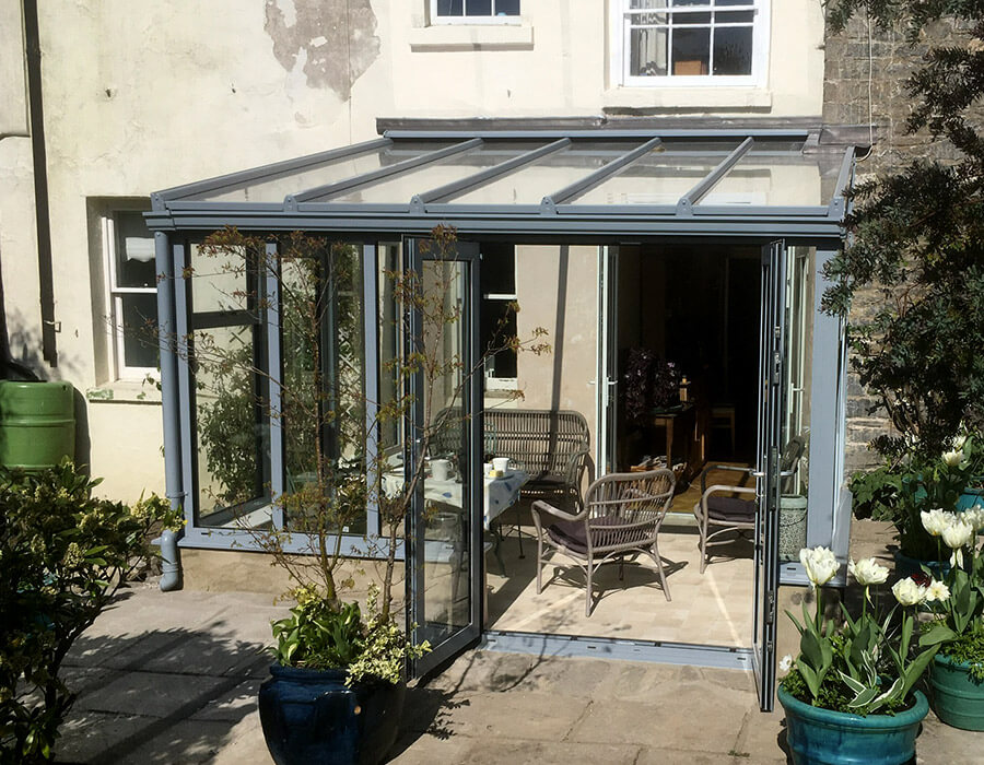 Grey uPVC lean to conservatory exterior