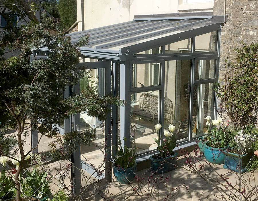 Grey uPVC lean to conservatory side view