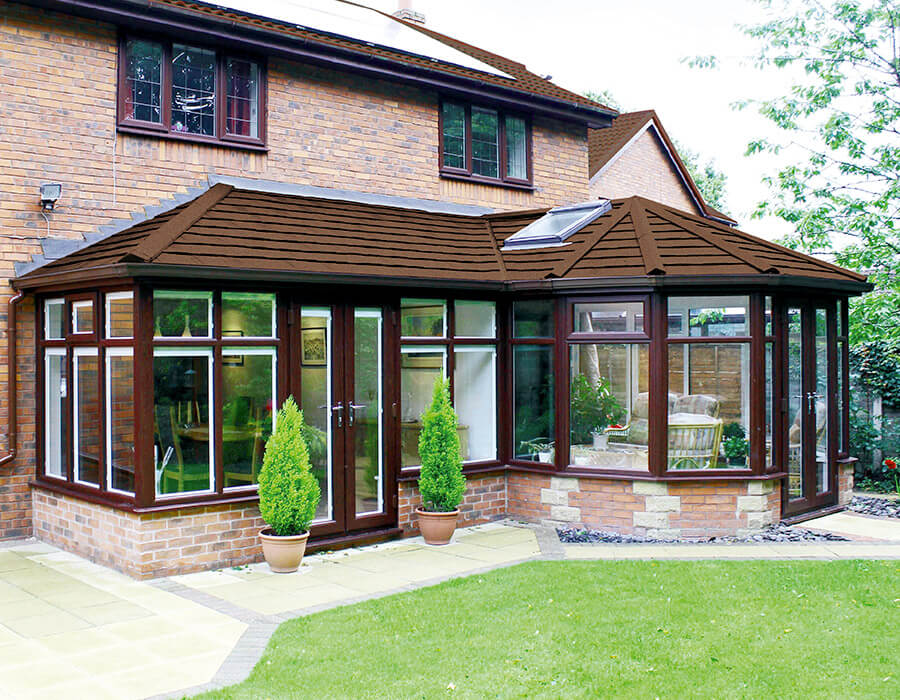 Rosewood effect P-Shaped conservatory with a tiled roof