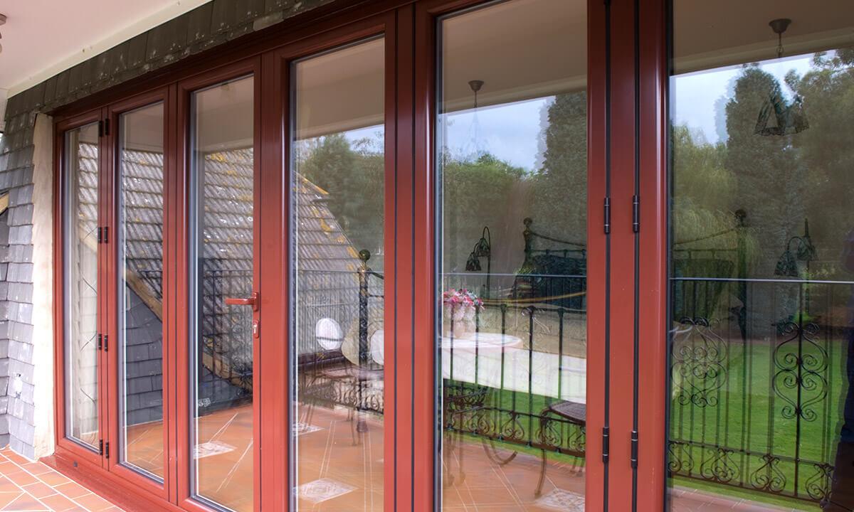 Red aluminium bifold door