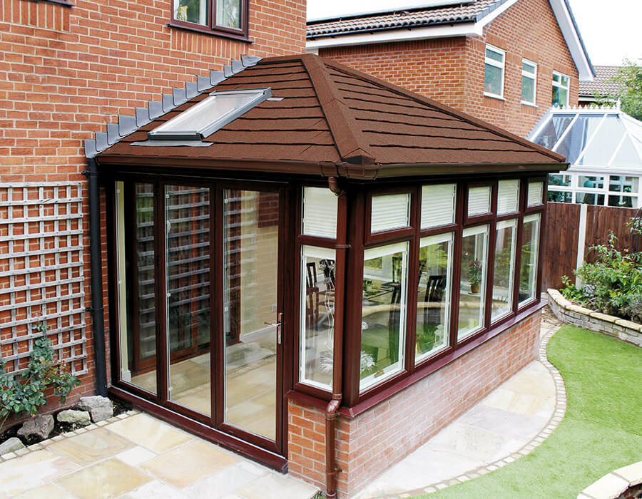 Rosewood uPVC edwardian conservatory with a tiled roof