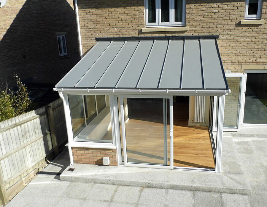 White uPVC lean to conservatory with a solid roof