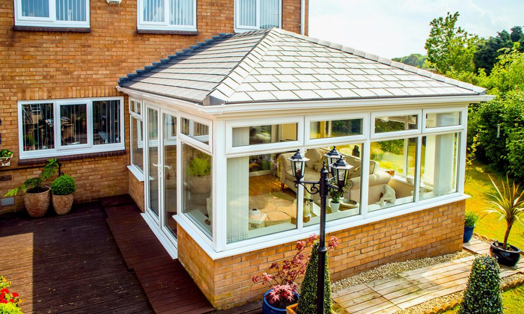 White uPVC conservatory with a tiled roof