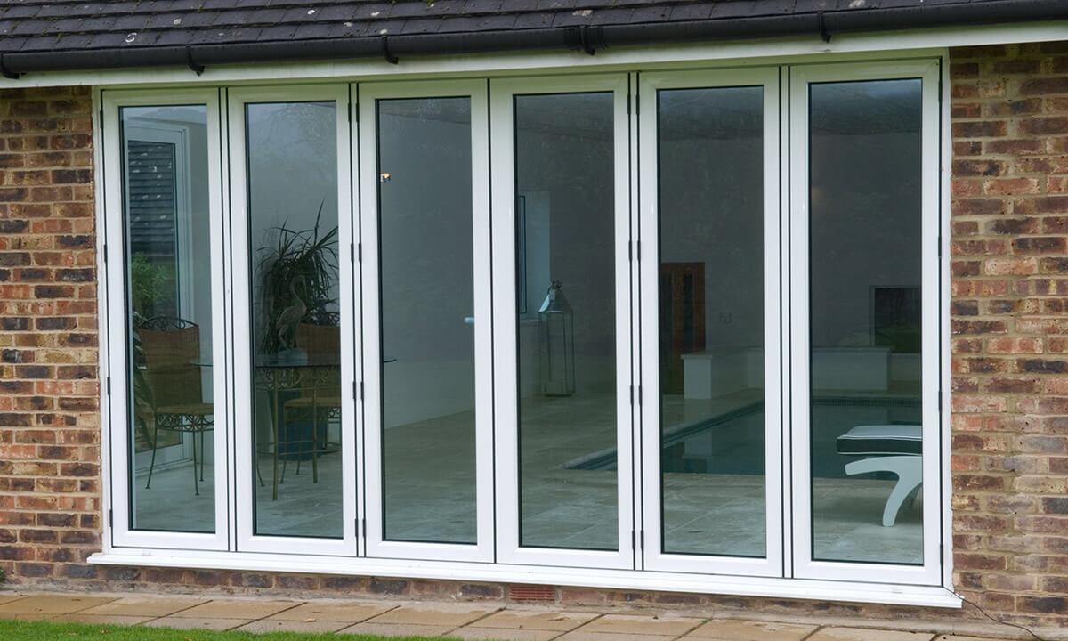 White aluminium bifold door