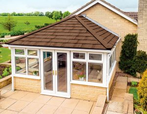 White uPVC conservatory with a brown tiled roof