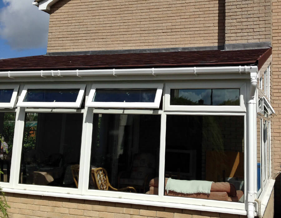 White Upvc Lean To Conservatory With Red Tiled Roof