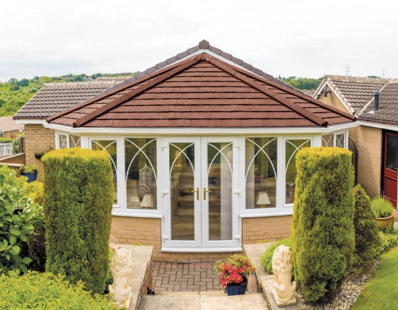 White uPVC victorian conservatory with a brown tiled replacement conservatory roofs