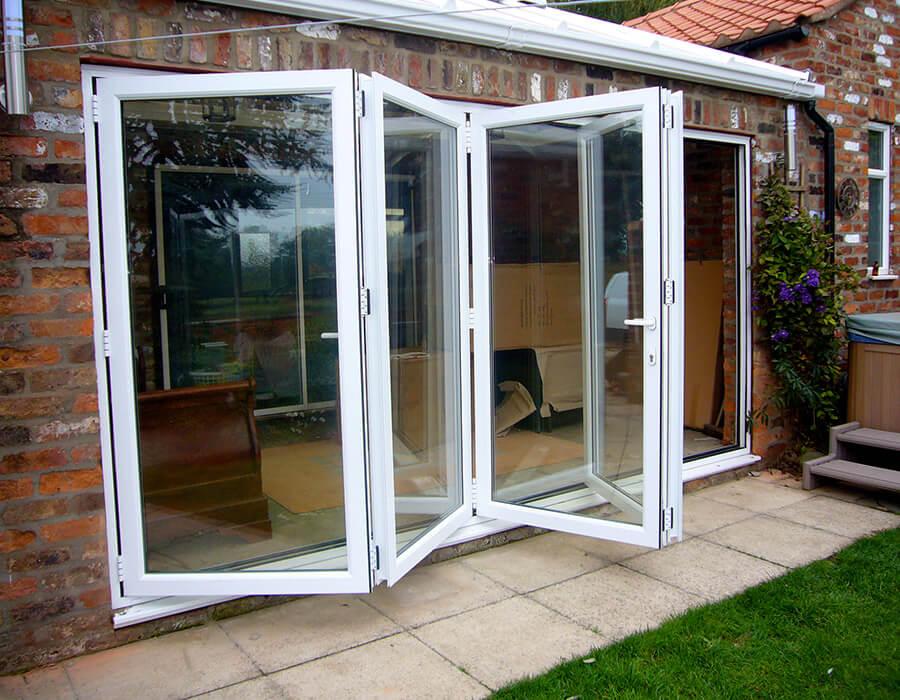 Open white uPVC bifold door